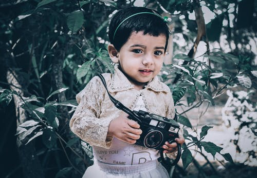 Free stock photo of analog camera, baby girl, black camera