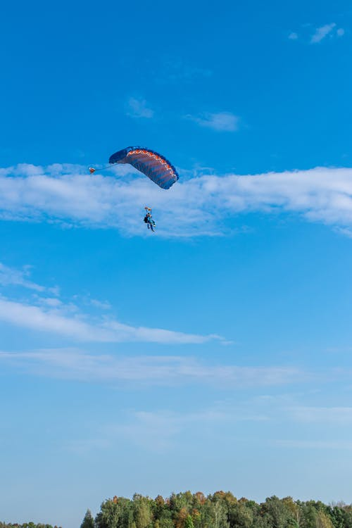 Person Paragliding from Afar