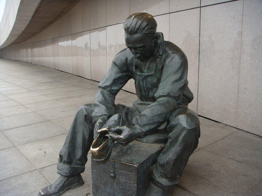 Free stock photo of the bronze cobbler