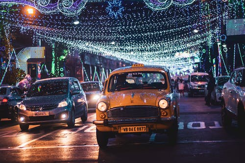 Traffic on road with garlands and lights