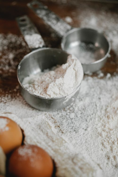 Flour in metal bowls for baking in kitchen