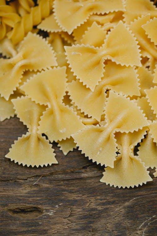 Heap of uncooked Italian pasta on table