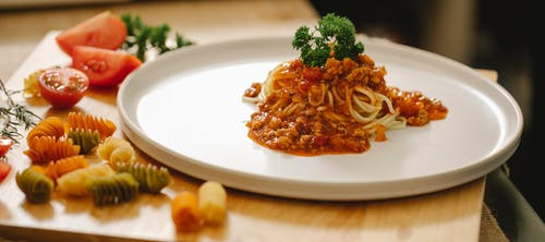 Plate with tasty pasta served with parsley