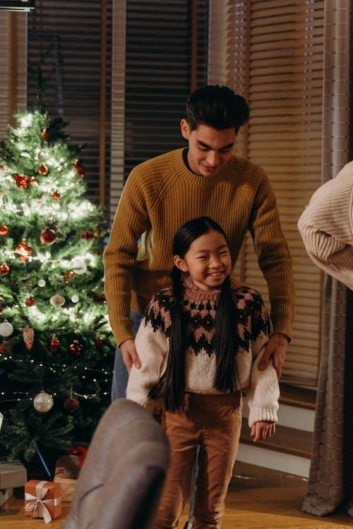 Father and Daughter Celebrating Yuletide Together