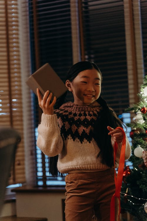 Smiling Girl Holding a Gift