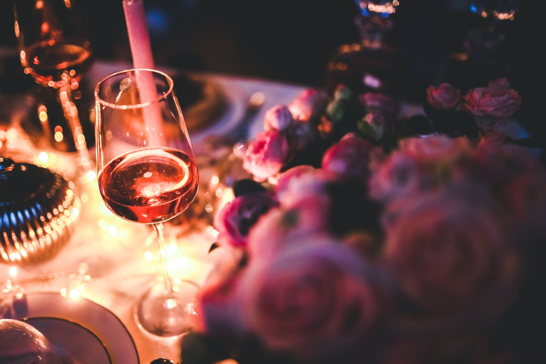 A glass of wine and roses
