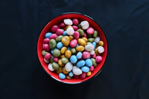 Red Ceramic Bowl With Assorted Color of Candies
