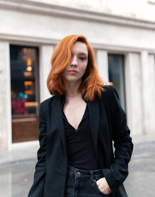 Woman in Black Blazer Standing Near Building
