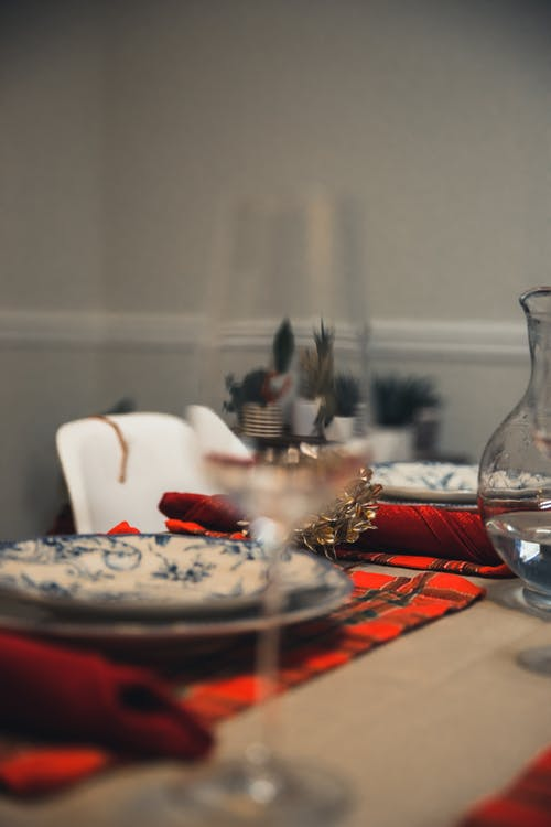 Table with napkins served with tableware