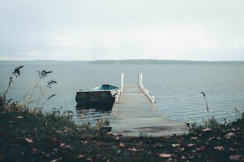 Blue Boat on Dock