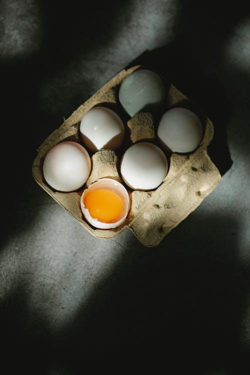 Set of fresh raw white eggs in cardboard box