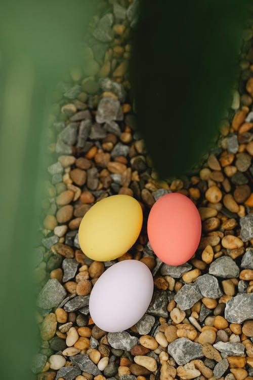 Easter eggs on pebble near leaf