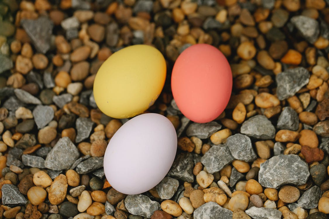 Colorful Easter eggs on pebble