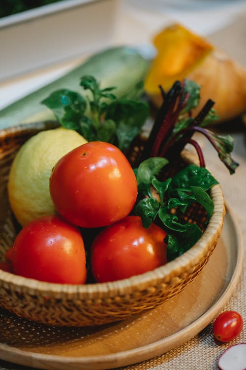Red Tomatoes on Brown Woven Basket
