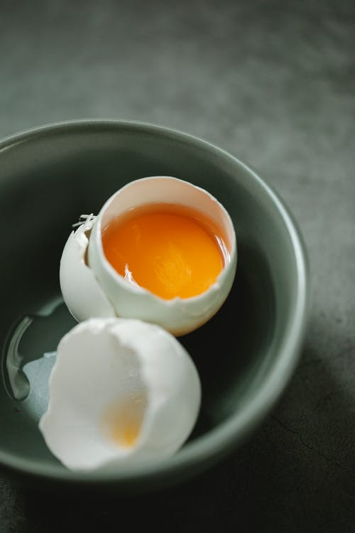 Raw egg placed in bowl