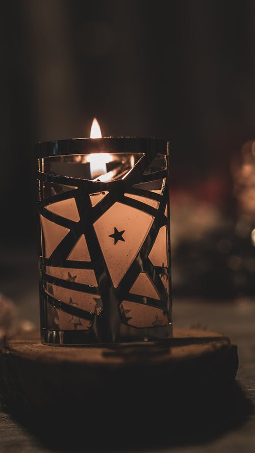 Lighted Candle in Black Metal Candle Holder
