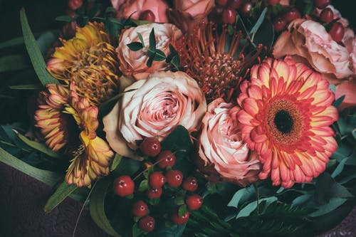 Bunch of assorted fresh flowers composed with green leaves