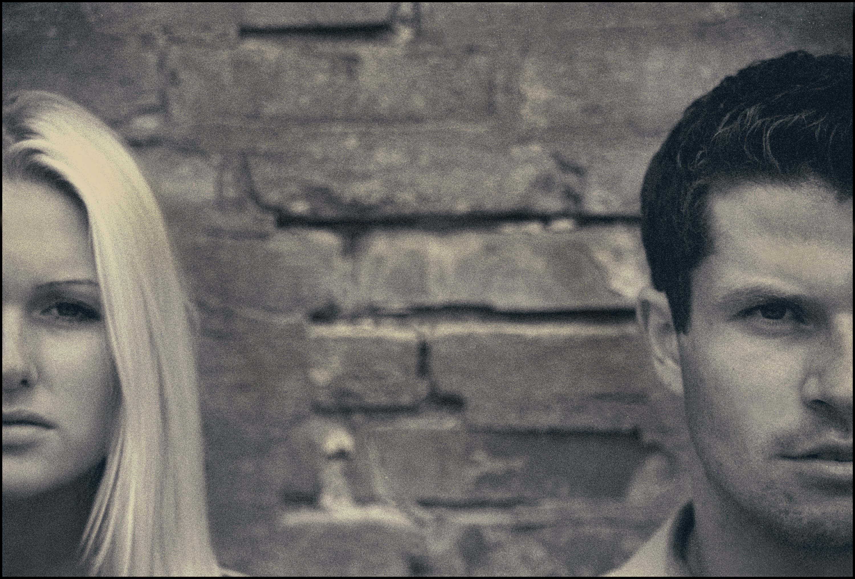 Grayscale Photo of Man and Woman