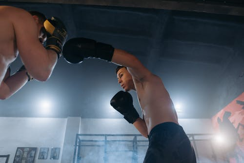 Man in Black Shorts and Black Boxing Gloves
