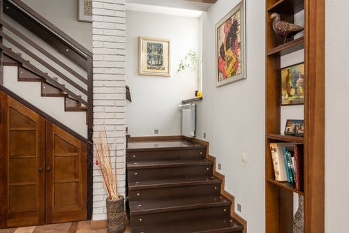 Staircase with wooden steps in apartment