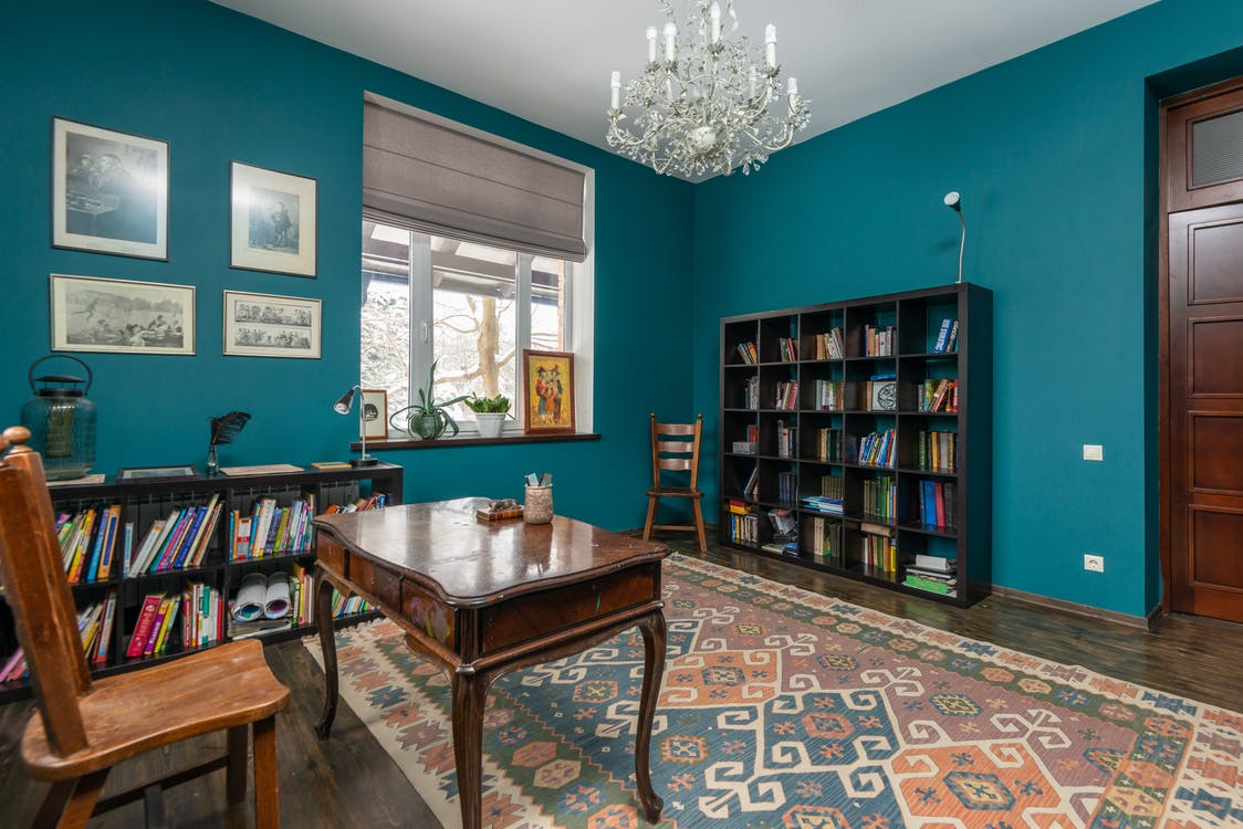 Interior of room with bookshelves and table