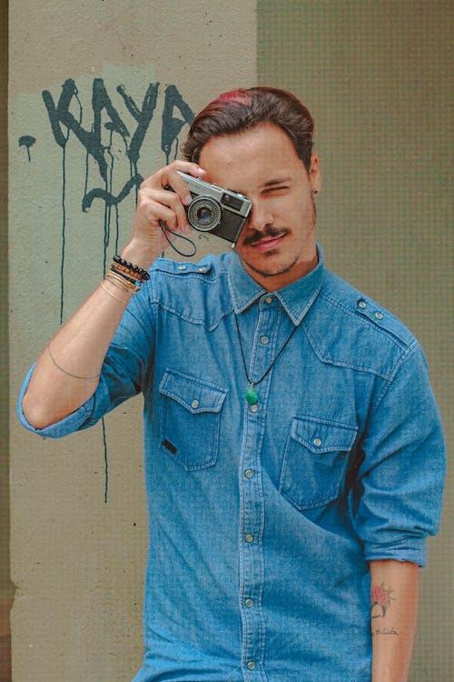 Stylish male photographer with old fashioned photo camera