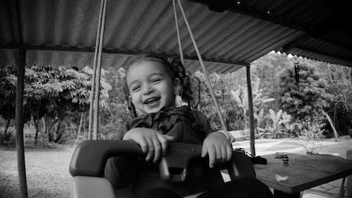 Cute little girl on swings