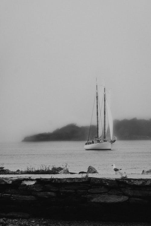 Small sailboat floating on peaceful seawater