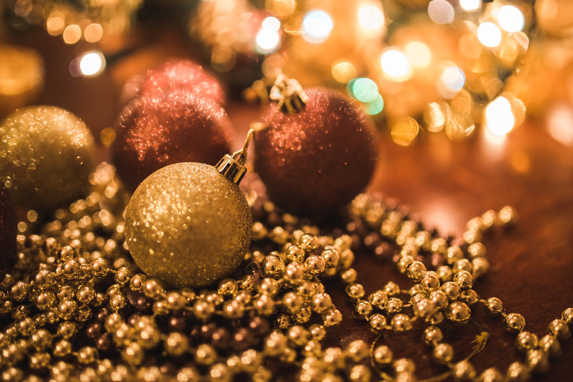 A photo of Christmas ornaments sitting on a table. Photo by pexels user Kaboompics.com. Used courtesy of Pexels.com.