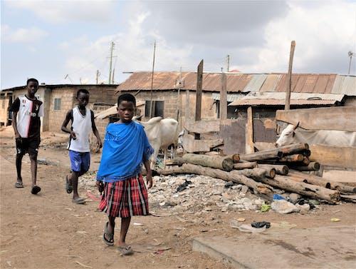 Children Walking on an Unpaved Road