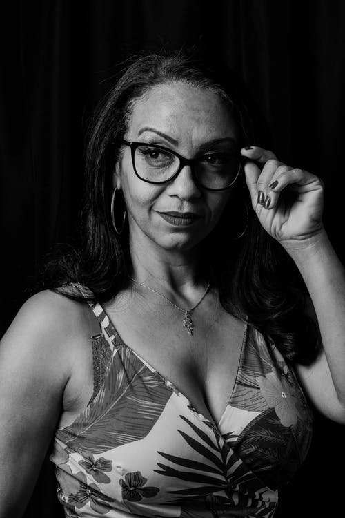 Monochrome Photo of Middle Aged Woman Wearing Spectacles