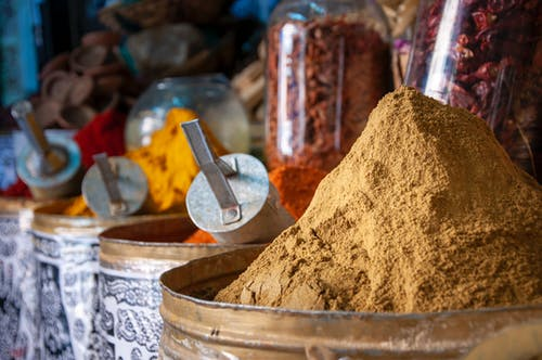 Various colorful spices in local market on sunny day