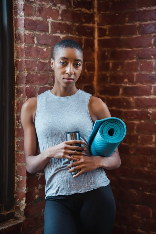Active black woman in gym