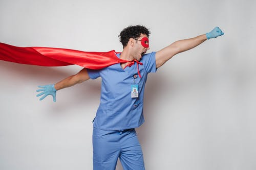 Expressive doctor in superhero costume