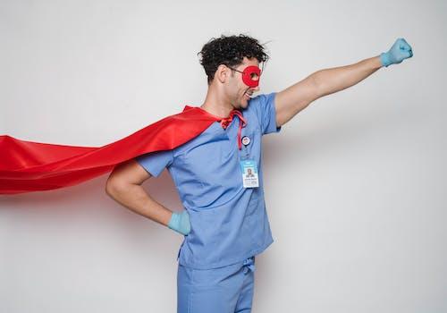 Positive doctor in red superhero costume