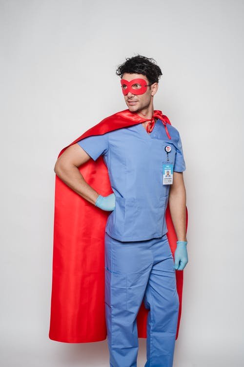 Serious doctor in uniform and superhero costume
