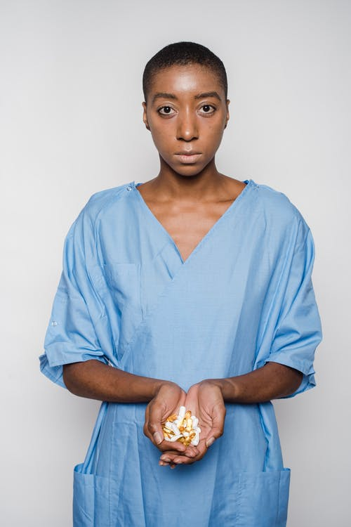 African American woman with handful of pills
