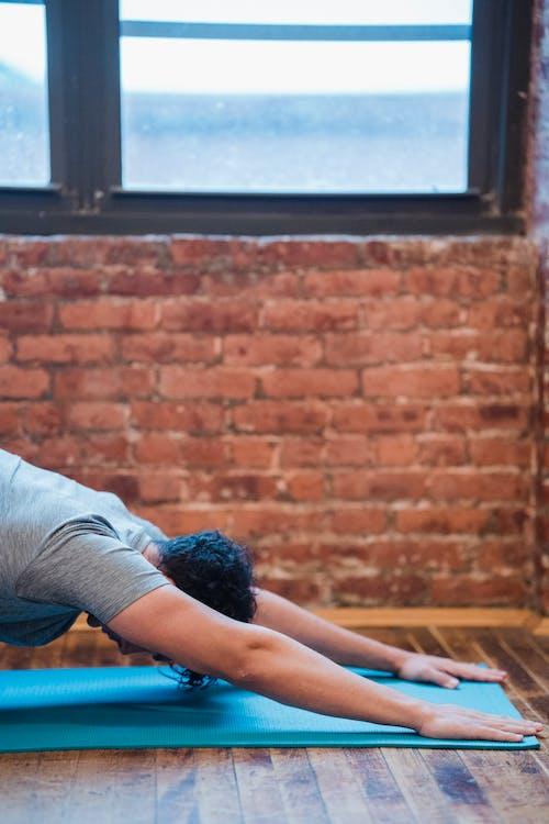 Man doing Extended Puppy yoga asana