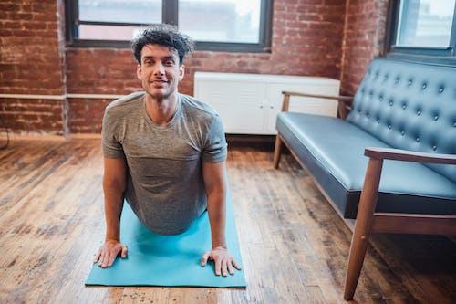 Positive man strengthening spine in High Cobra position