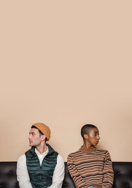 Man in Brown Knit Cap Beside Woman in Blue Jacket