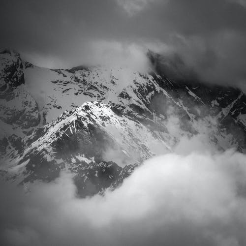 A Grayscale Photo of a Mountain Covered with Snow