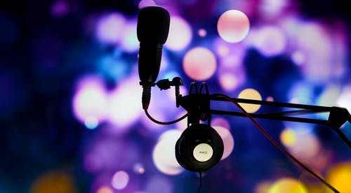 A Close-Up Shot of a Microphone and Headphones