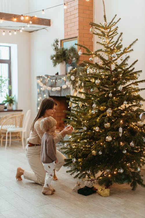 Mom and Child Decorating the Christmas Tree