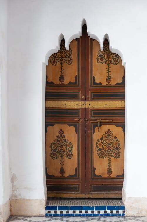 Painted door in traditional Moroccan palace in daytime