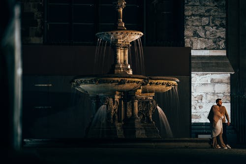 Brown Concrete Outdoor Fountain during Night Time