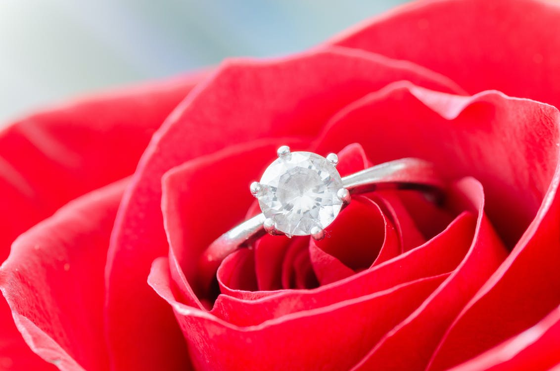 Macro Shot of Solitaire Ring on Flower