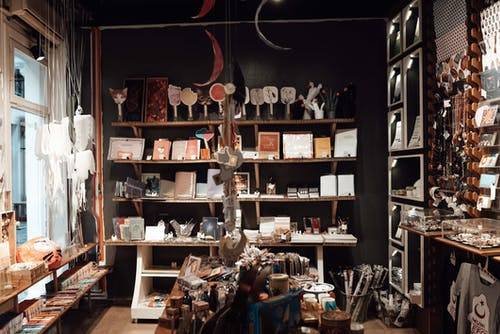 Aged souvenir shop with various gifts and vintage goods placed on wooden shelves