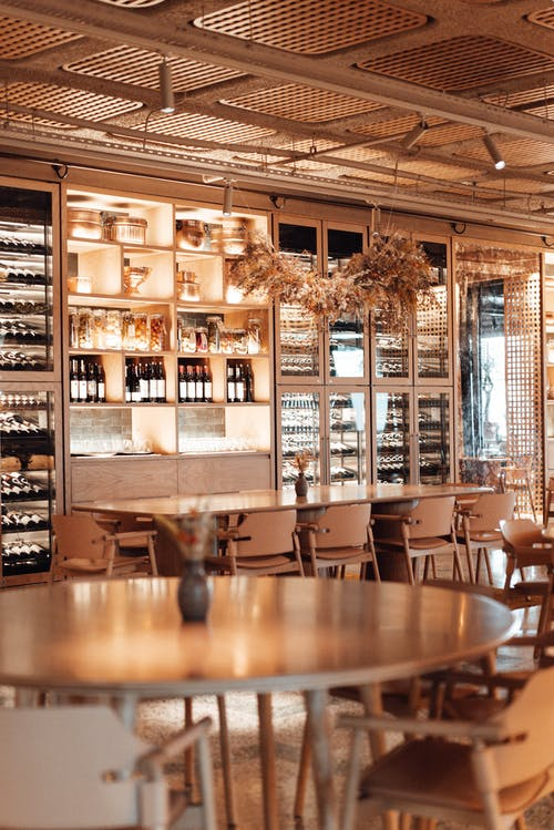 Interior of stylish restaurant with wine wall