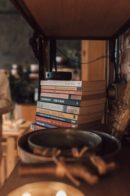 Wooden shelf with books and decorative elements