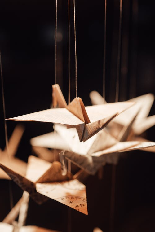 Decorative origami cranes hanging on threads